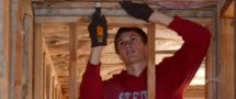 Taylor Burd installs insulation at the Port Colden duplex